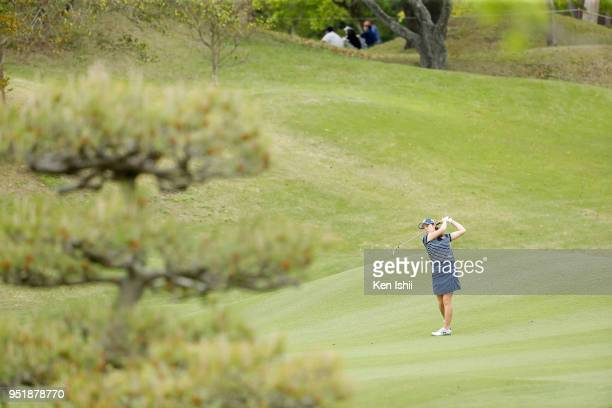Yukari Nishiyama of Japan hits an approach shot on the 8th hole during the first round of the CyberAgent Ladies Golf Tournament at Grand fields...