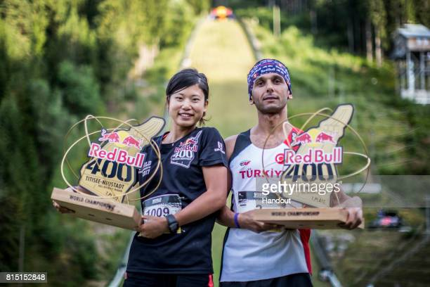 Yukari Tanaka of Japan and Ahmet Arslan of Turkey celebrate with their winners trophies after the Red Bull 400 World Championship at TitiseeNeustadt...