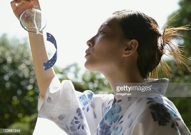 Yukata dressed woman and wind-chime