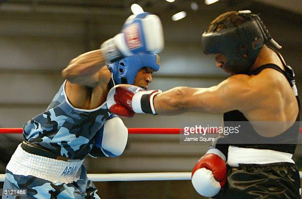Yukence Andino punches DeAndrey Abron during the United States Olympic Team Boxing Trials at Battle Arena on February 19 2004 in Tunica Mississippi