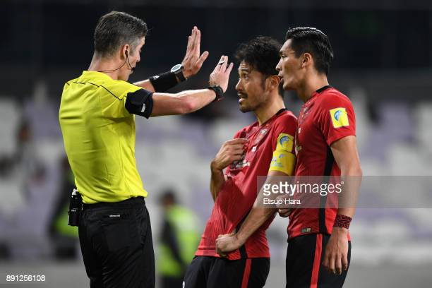 Yuki Abe and Tomoaki Makino of Urawa Red Diamonds protest to referee Matt Conger of New Zealand during the FIFA Club World Cup UAE 2017 Match for 5th...