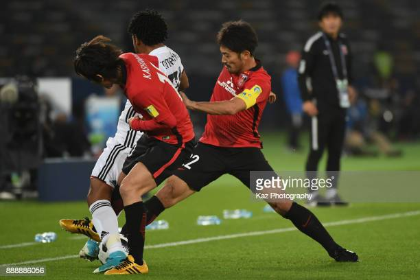 Yuki Abe and Yosuke Kashiwagi of Urawa Reds challenges Romarinho of Al Jazira> on December 9 2017 in Abu Dhabi United Arab Emirates