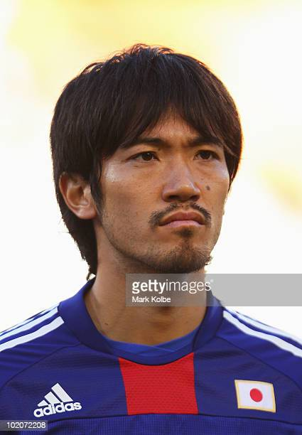 Yuki Abe of Japan lines up for the national anthems prior to the 2010 FIFA World Cup South Africa Group E match between Japan and Cameroon at the...