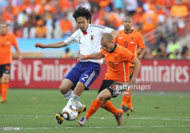 Yuki Abe of Japan tackles Wesley Sneijder of the Netherlands during the 2010 FIFA World Cup South Africa Group E match between Netherlands and Japan...