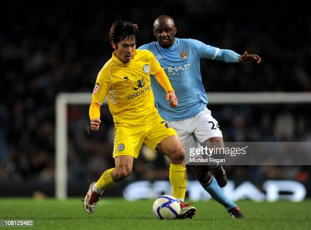 Yuki Abe of Leicester City competes with Patrick Vieira of Manchester City during the FA Cup sponsored by EOn Third Round Replay match between...