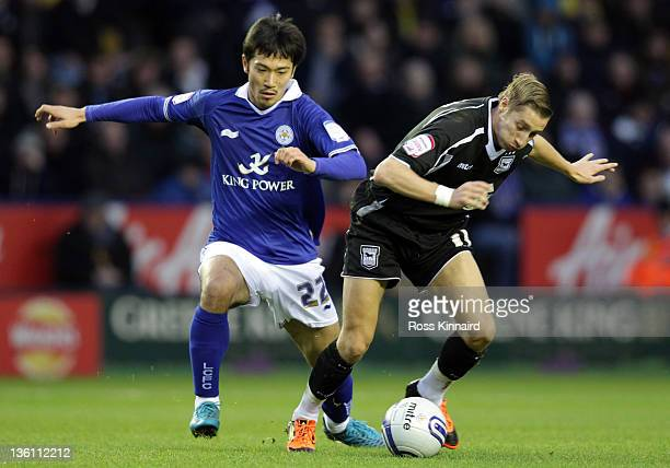 Yuki Abe of Leicester is challenged by Lee Martin of Ipswichduring the npower Championship match between Leicester City and Ipswich Town at The King...