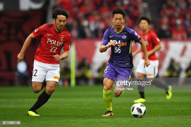 Yuki Abe of Urawa Red Diamonds and Hayao Kawabe of Sanfrecce Hiroshima compete for the ball during the JLeague J1 match between Urawa Red Diamonds...