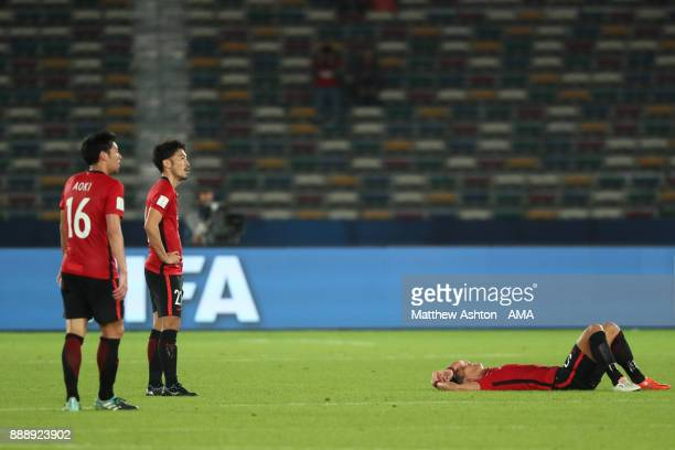 Yuki Abe of Urawa Red Diamonds and his teammates look dejected at the end of the FIFA Club World Cup UAE 2017 match between Al Jazira and Urawa Red...