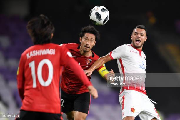 Yuki Abe of Urawa Red Diamonds and Mohamed Aoulad Youssef of Wydad Casablanca compete for the ball during the FIFA Club World Cup UAE 2017 Match for...
