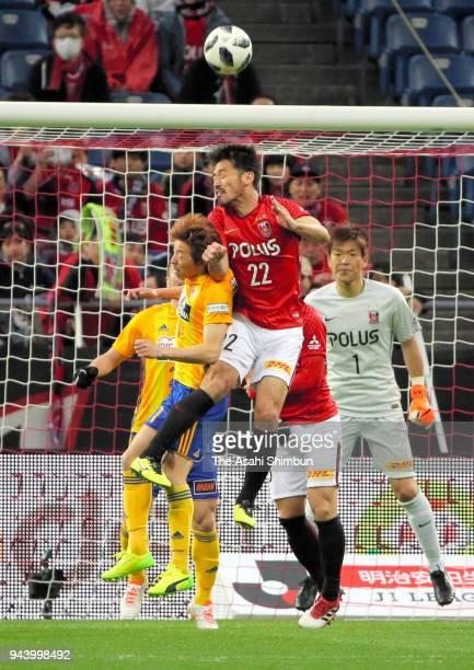 Yuki Abe of Urawa Red Diamonds and Naoki Ishihara of Vegalta Sendai compete for the ball during the JLeague J1 match between Urawa Red Diamonds and...