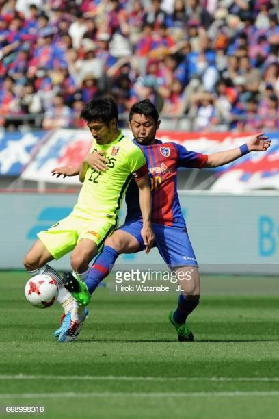 Yuki Abe of Urawa Red Diamonds and Yohei Kajiyama of FC Tokyo compete for the ball during the J.League J1 match between FC Tokyo and Urawa Red...