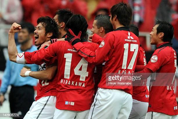 Yuki Abe of Urawa Red Diamonds celebrates the first goal with his teammates during the JLeague match between Urawa Red Diamonds and Vissel Kobe at...