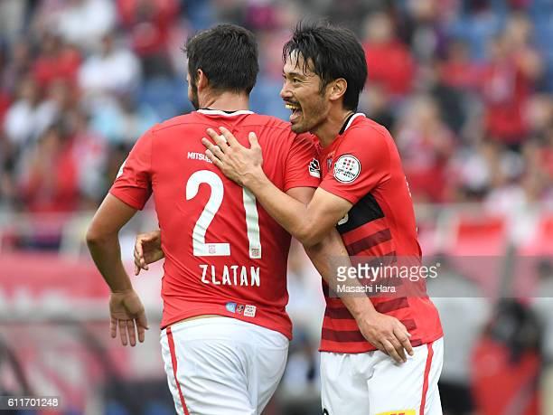 Yuki Abe of Urawa Red Diamonds celebrates their fourth goal during the JLeague match between Urawa Red Diamonds and Gamba Osaka at Saitama Stadium on...