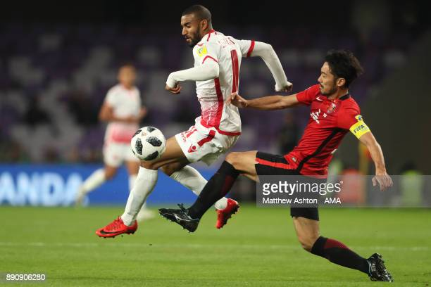 Yuki Abe of Urawa Red Diamonds challenges Ismail El Haddad of Wydad Casablanca during the FIFA Club World Cup UAE 2017 fifth place playoff match...