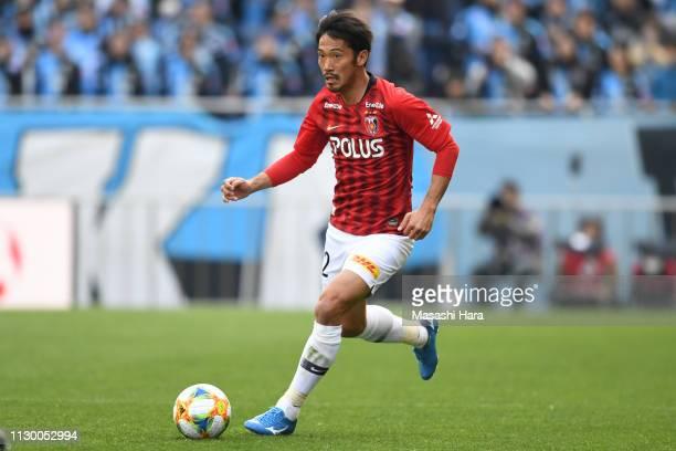Yuki Abe of Urawa Red Diamonds in action during the Fuji Xerox Super Cup between Kawasaki Frontale and Urawa Red Diamonds at Saitama Stadium on...