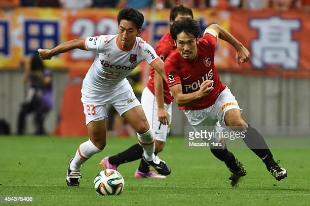 Yuki Abe of Urawa Red Diamonds in action during the J League match between Urawa Red Diamonds and Omiya Ardija at Saitama Stadium on August 30 2014...