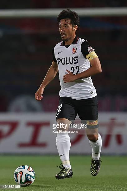 Yuki Abe of Urawa Red Diamonds in action during the JLeague Yamazaki Nabisco Cup Group B match between Ventforet Kofu and Urawa Red Diamodns at...