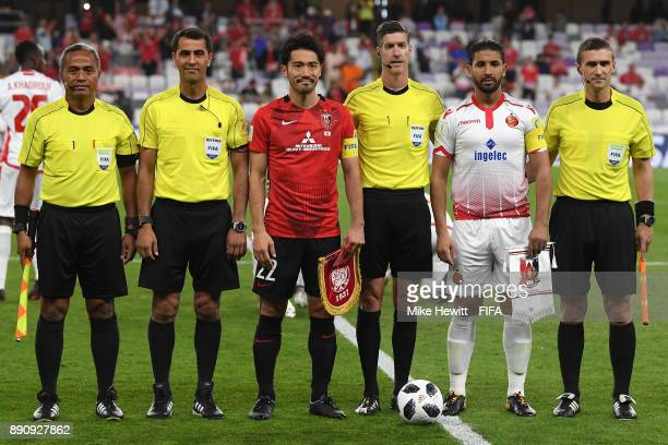 Yuki Abe of Urawa Reds and Youssef Rabeh of Wydad Casablanca line up ahead of the FIFA Club World Cup UAE 2017 fifth place playoff match between...