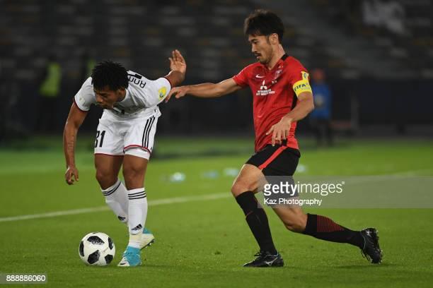 Yuki Abe of Urawa Reds challenges Romarinho of Al Jazira> on December 9 2017 in Abu Dhabi United Arab Emirates
