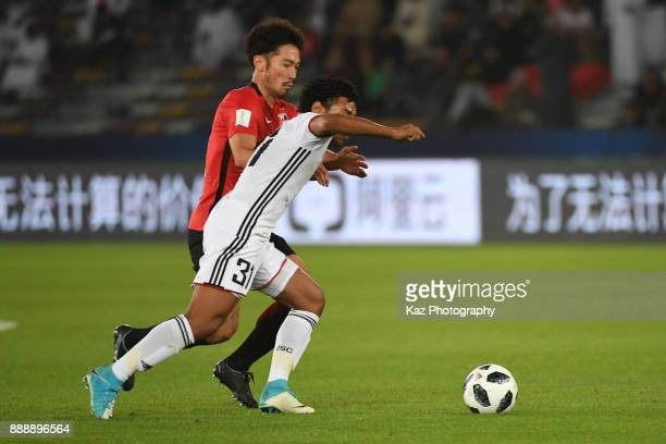 <Yuki Abe of Urawa Reds challenges Romarinho of Al Jazira> on December 9 2017 in Abu Dhabi United Arab Emirates