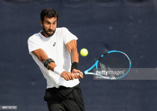 Yuki Bhambri of India in action against Alex De Minaur of Australia during their Quarter Final match on Day 7 of the Fuzion 100 Surbition Trophy on...