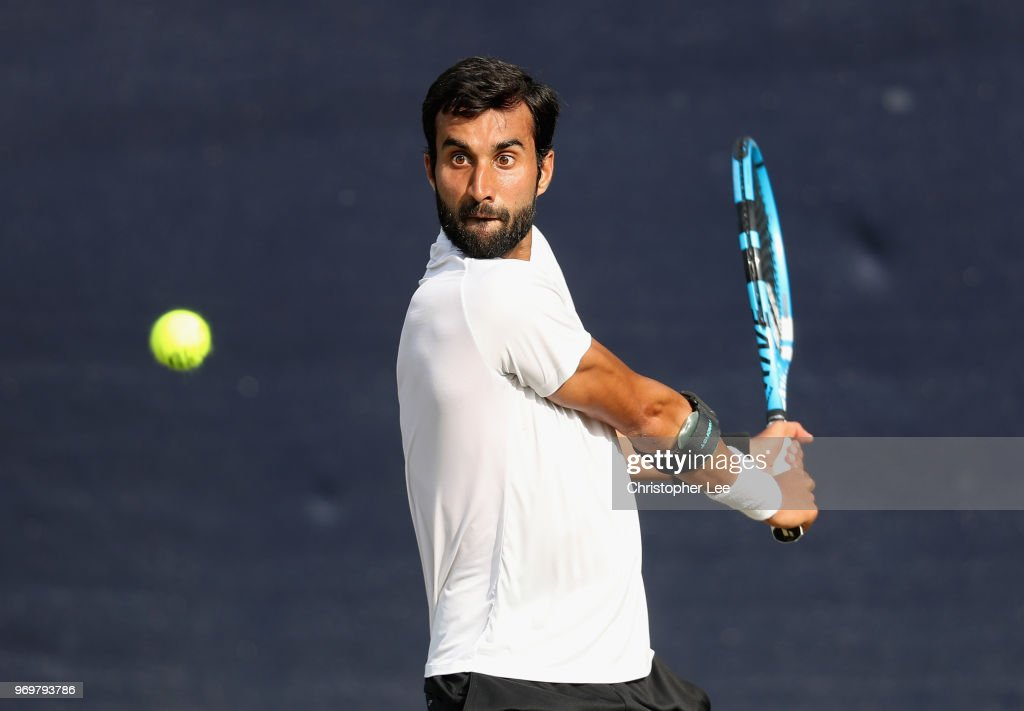 Yuki Bhambri of India in action against Alex De Minaur of Australia during their Quarter Final match on Day 7 of the Fuzion 100 Surbition Trophy on June 8, 2018 in London, United Kingdom.