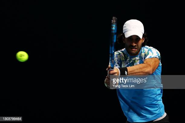 Yuki Bhambri of India plays a backhand in his Men's Singles first round match against Matthew Ebden of Australia on day three of the Singapore Tennis...