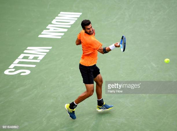Yuki Bhambri of India plays a forehand in his match against Sam Querrey of the United States during the BNP Paribas Open at the Indian Wells Tennis...