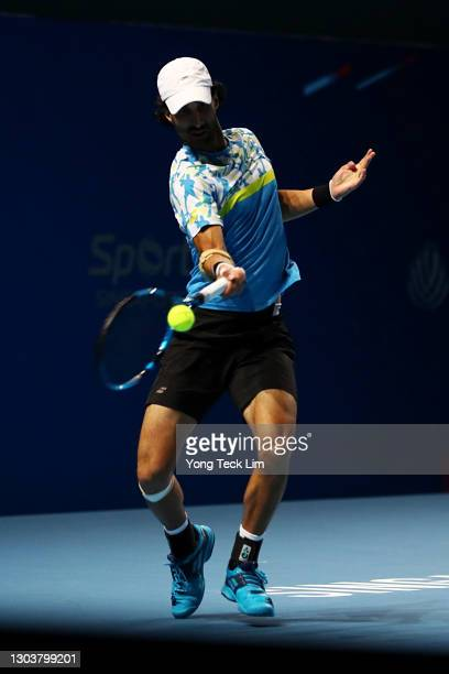 Yuki Bhambri of India plays a forehand in his Men's Singles first round match against Matthew Ebden of Australia on day three of the Singapore Tennis...