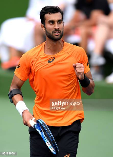 Yuki Bhambri of India reacts to set point in his match against Sam Querrey of the United States during the BNP Paribas Open at the Indian Wells...