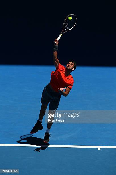 Yuki Bhambri of India serves his first round match against Tomas Berdych of the Czech Republic during day one of the 2016 Australian Open at...