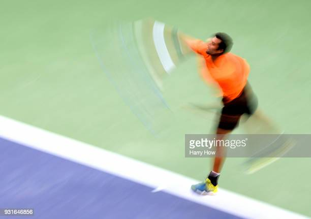 Yuki Bhambri of India serves in his match against Sam Querrey of the United States during the BNP Paribas Open at the Indian Wells Tennis Garden on...