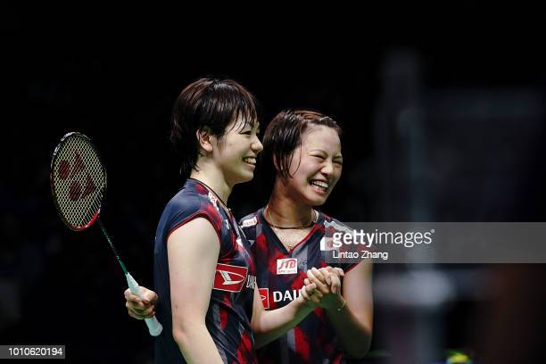 Yuki Fukushima and Sayaka Hirota of Japan celebrate after defeating Shiho Tanaka and Koharu Yonemoto of Japan in their women's doubles semifinal...