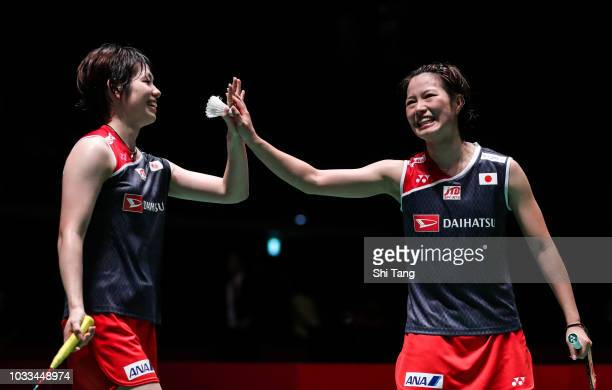 Yuki Fukushima and Sayaka Hirota of Japan celebrate the victory after their Women's Doubles semi finals against Greysia Polii and Apriyani Rahayu of...