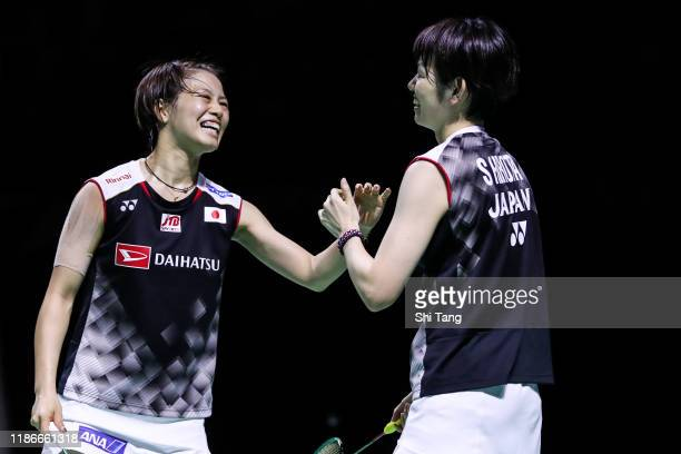 Yuki Fukushima and Sayaka Hirota of Japan celebrate the victory in the Women's Double final match against Lee So Hee and Shin Seung Chan of Korea on...