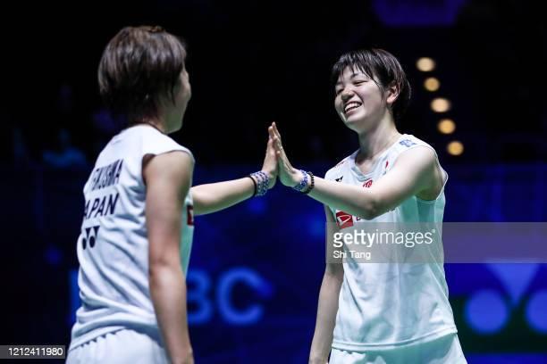 Yuki Fukushima and Sayaka Hirota of Japan celebrate the victory in the Women's Doubles semi finals match against Misaki Matsutomo and Ayaka Takahashi...