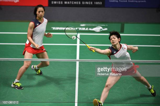 Yuki Fukushima and Sayaka Hirota of Japan compete against Chen Qingchen and Jia Yifan of China during Women's Team final match between Japan and...