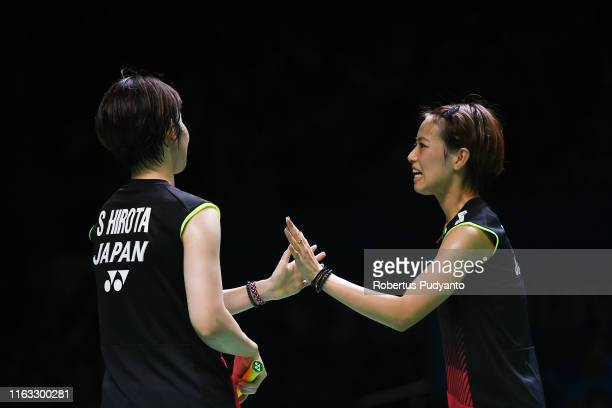 Yuki Fukushima and Sayaka Hirota of Japan compete against Misaki Matsutomo and Ayaka Takahashi of Japan during the Women's Doubles Final match on day...