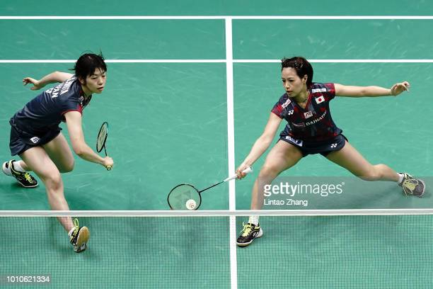 Yuki Fukushima and Sayaka Hirota of Japan compete against Shiho Tanaka and Koharu Yonemoto of Japan in their women's doubles semifinal match during...