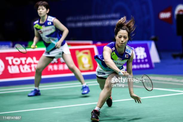 Yuki Fukushima and Sayaka Hirota of Japan compete in the Women's Doubles match against Ekaterina Bolotova and Alina Davletova of Russia during day...