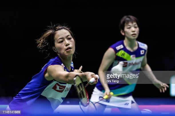 Yuki Fukushima and Sayaka Hirota of Japan compete in the Women's Doubles match against Ekaterina Bolotova and Alina Davletova of Russia during day...