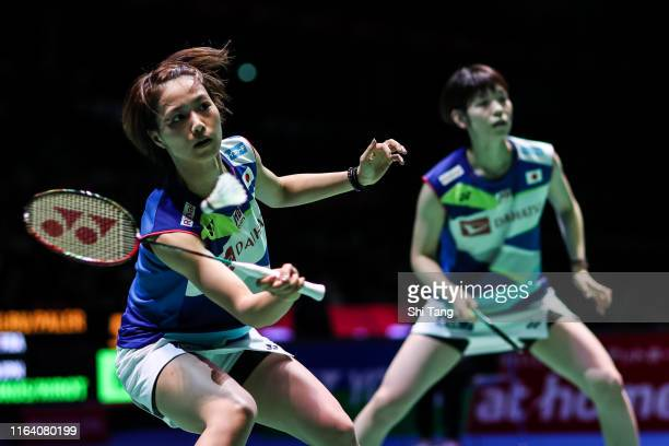 Yuki Fukushima and Sayaka Hirota of Japan compete in the Women's Doubles second round match against Delphine Delrue and Lea Palermo of France during...