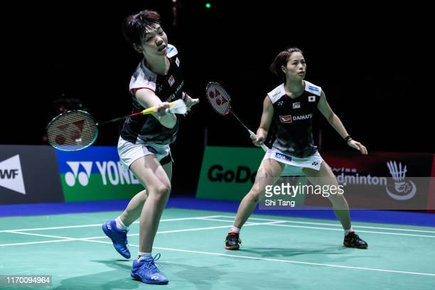 Yuki Fukushima and Sayaka Hirota of Japan compete in the Women's Double final match against Mayu Matsumoto and Wakana Nagahara of Japan during day...