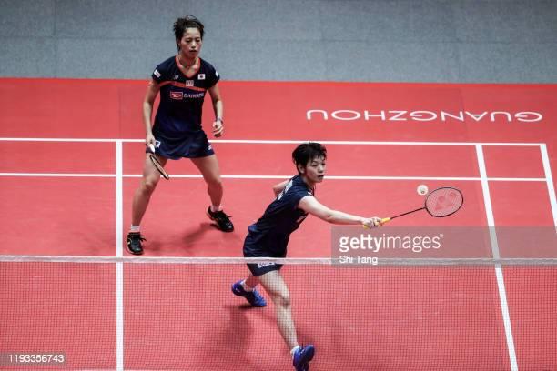 Yuki Fukushima and Sayaka Hirota of Japan compete in the Women's Doubles round robin match against Greysia Polii and Apriyani Rahayu of Indonesia...