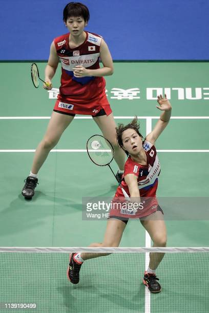 Yuki Fukushima and Sayaka Hirota of Japan hits a return during the women's doubles match against Du yue and Li Yinhui of China at the 2019 Badminton...
