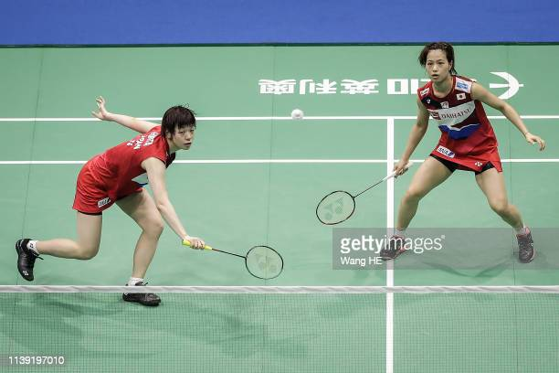 Yuki Fukushima and Sayaka Hirota of Japan hits a return during the women's doubles match against Du yue and Li Yinhui of China at the 2019 Badminton...