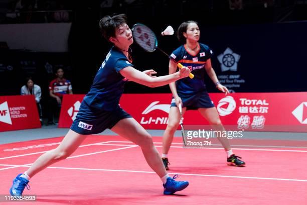 Yuki Fukushima and Sayaka Hirota of Japan in action against Greysia Polii and Apriyani Rahayu of Indonesia on day 1 of the HSBC BWF World Tour Finals...