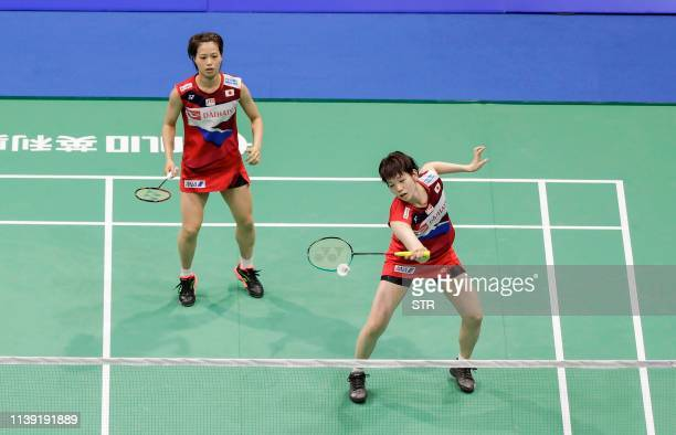 Yuki Fukushima and Sayaka Hirota of Japan play a return against Du Yue and Li Yinhui of China during their women's doubles second round match at the...