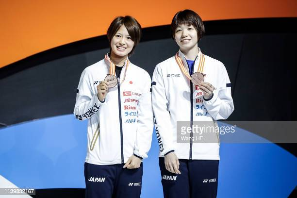 Yuki Fukushima and Sayaka Hirota of Japan pose Bronze medals on the podium at the 2019 Badminton Asia Championships on Apirl 28 2019 in Wuhan central...