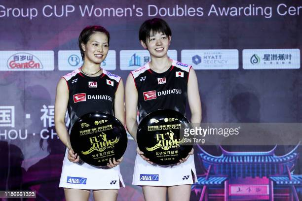Yuki Fukushima and Sayaka Hirota of Japan pose with their trophies after the Women's Double final match against Lee So Hee and Shin Seung Chan of...